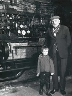 Walter James Seward, eldest son of Jim Seward, with his grandson Barry Wakelin in the workshop, Chapel Street. Circa 1969.