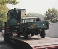 Neil Gough's Land Rover carefully positions the living van on the trailer