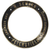 "Cast Engine ring with the wording ""W.SEWARD, PETERSFIELD, ENGINEER AND HAULAGE CONTRACTOR"". This ring was on the front of Mclaren 7hp locomotive number 726 of 1903"